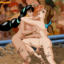Jasmine and Belle fight in the mud pit